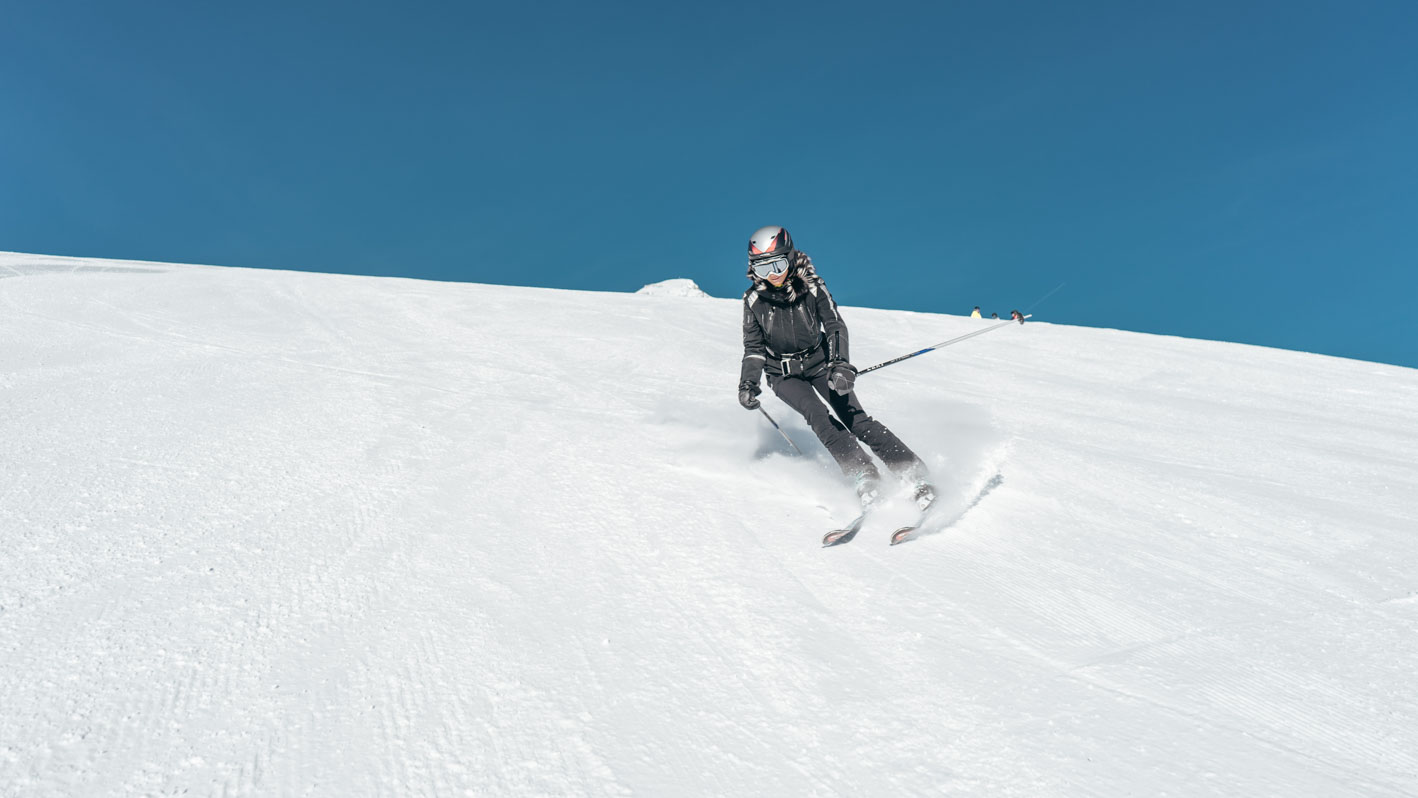 Woman Skiing on Slope